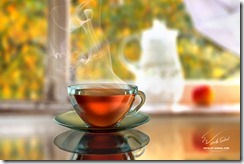 Hot steamy black tea in front of a window glass with water drops in an autumn rainy day
